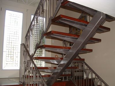 These Interior Steel Stairs Have A Center Tube Stringer And Custom  Fabricated Plate Treads For Wood.
